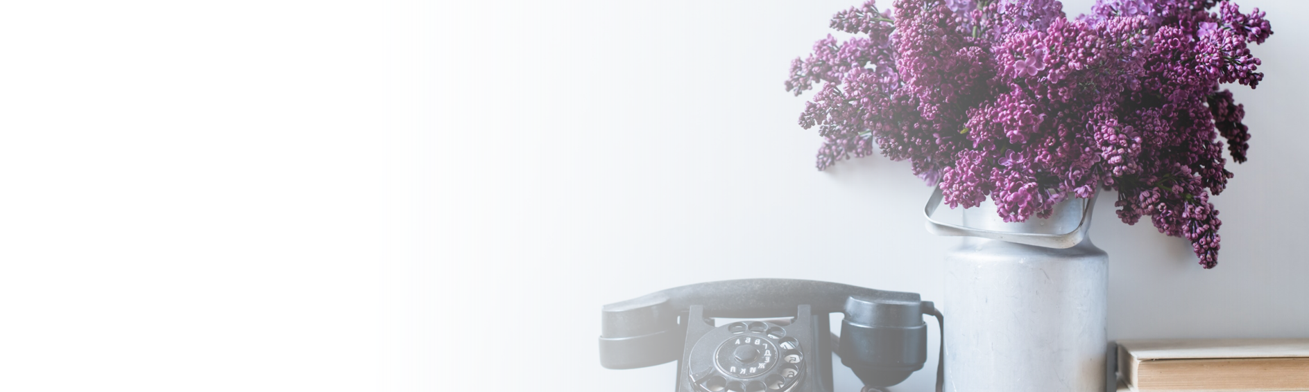 rotary phone and bouquet on desk